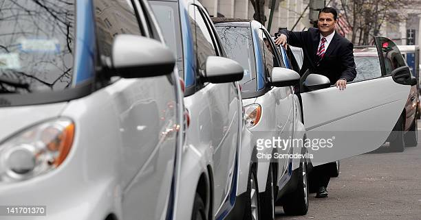Car2go President and CEO Nicholas C Cole poses with a row of vehicles on display March 22 2012 in Washington DC Beginning March 24 car2go will offer...