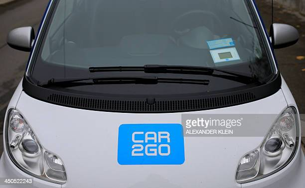 A car2go rental car generally used for short term urban rentals is seen in the streets of Vienna on November 15 2013 AFP PHOTO / ALEXANDER KLEIN