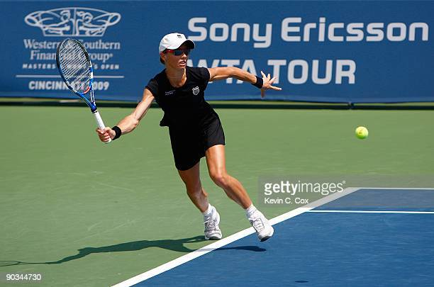 Cara Black of Zimbabwe looks to play the baseline volley against Nuria Llagostera Vives and Maria Jose Martinez Sanchez both of Spain during the...