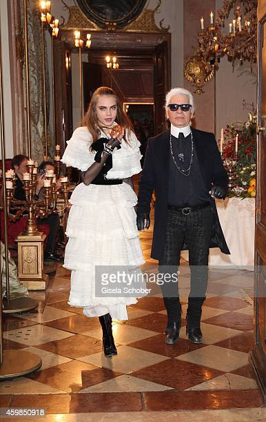 Cara Delevigne and Designer Karl Lagerfeld during the Chanel Metiers d'Art Collection 2014/15 ParisSalzburg on December 2 2014 in Salzburg Austria