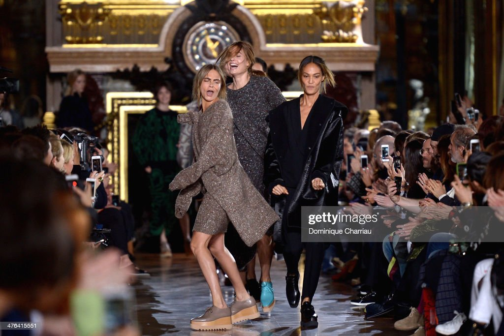 Cara Delevigne and <a gi-track='captionPersonalityLinkClicked' href=/galleries/search?phrase=Joan+Smalls&family=editorial&specificpeople=5714628 ng-click='$event.stopPropagation()'>Joan Smalls</a> walk the runway during the Stella McCartney show as part of the Paris Fashion Week Womenswear Fall/Winter 2014-2015 on March 3, 2014 in Paris, France.