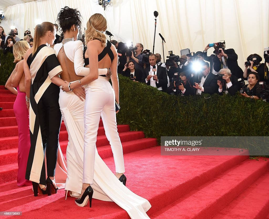 Cara Delevigne, <a gi-track='captionPersonalityLinkClicked' href=/galleries/search?phrase=Rihanna&family=editorial&specificpeople=453439 ng-click='$event.stopPropagation()'>Rihanna</a>, <a gi-track='captionPersonalityLinkClicked' href=/galleries/search?phrase=Stella+McCartney+-+Fashion+Designer&family=editorial&specificpeople=4288678 ng-click='$event.stopPropagation()'>Stella McCartney</a>, and <a gi-track='captionPersonalityLinkClicked' href=/galleries/search?phrase=Reese+Witherspoon&family=editorial&specificpeople=201577 ng-click='$event.stopPropagation()'>Reese Witherspoon</a> arrive at the Costume Institute Benefit at The Metropolitan Museum of Art May 5, 2014 in New York. AFP PHOTO/Timothy A. CLARY