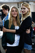 Cara Delevingne and a model backstage at the TopShop Unique show during London Fashion Week Spring Summer 2015 at TopShop Show Space on September 14...