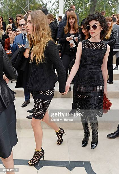 Cara Delevingne and Annie Clark arrive at Burberry Womenswear Spring/Summer 2016 show during London Fashion Week at Kensington Gardens on September...