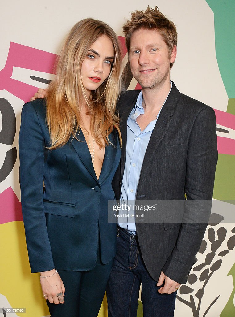Cara Delevingne and Christopher Bailey pose backstage at the Burberry Womenswear SS15 show during London Fashion week at Kensington Gardens on...