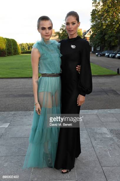 Cara Delevingne and Doutzen Kroes attend a dinner hosted by Doutzen Kroes and Lucy Yeomans in honour of Save the Elephants at The Orangery on June 12...