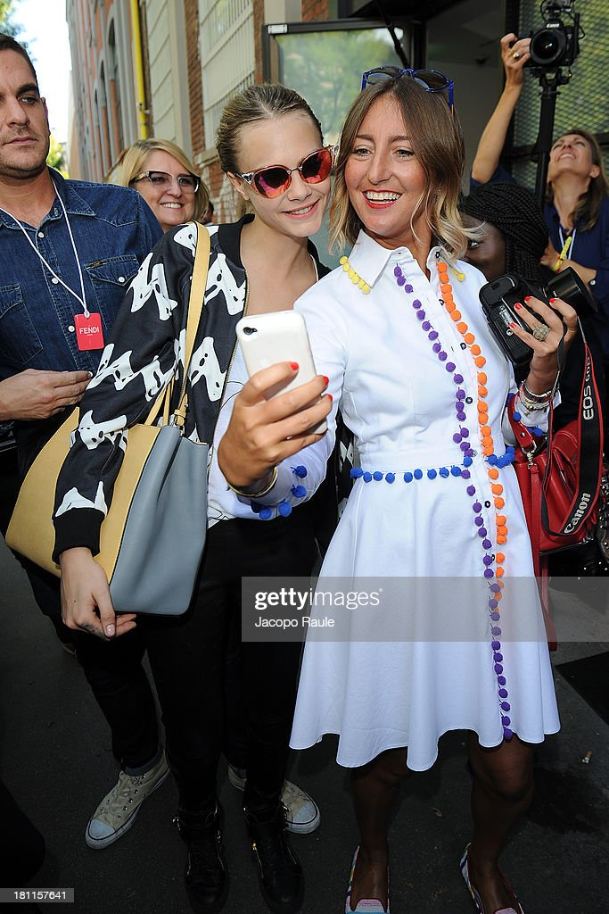 <a gi-track='captionPersonalityLinkClicked' href=/galleries/search?phrase=Cara+Delevingne&family=editorial&specificpeople=5488432 ng-click='$event.stopPropagation()'>Cara Delevingne</a> and Elena Braghieri are seen leaving the Fendi during Milan Fashion Week Womenswear Spring/Summer 2014 on September 19, 2013 in Milan, Italy.