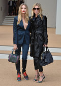 Cara Delevingne and Kate Moss attend the Burberry Prorsum show during London Fashion Week Spring Summer 2015 on September 15 2014 in London England