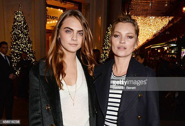 Cara Delevingne and Kate Moss attend 'The Magical Christmas Journey By Burberry' Printemps Collaboration at Le Printemps on November 6 2014 in Paris...