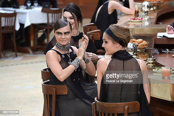 Cara Delevingne and Kendall Jenner seen during the Chanel show as part of the Paris Fashion Week Womenswear Fall/Winter 2015/2016 on March 10 2015 in...