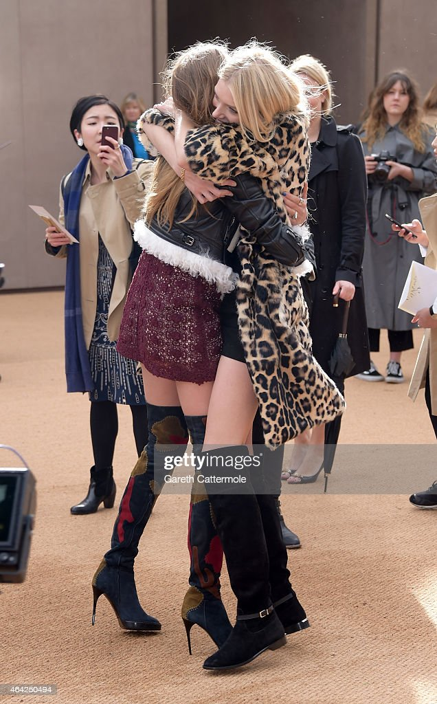 Cara Delevingne and Lily Donaldson attend the Burberry Prorsum AW 2015 arrivals during London Fashion Week at Kensington Gardens on February 23, 2015 in London, England.