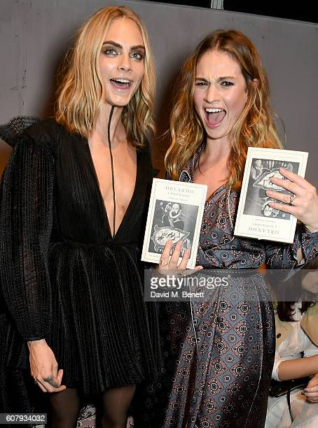 Cara Delevingne and Lily James wearing Burberry at the Burberry September 2016 show during London Fashion Week SS17 at Makers House on September 19...