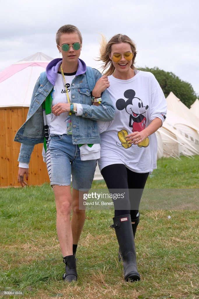 Cara Delevingne (L) and Margot Robbie attend day two of Glastonbury on June 24, 2017 in Glastonbury, England.