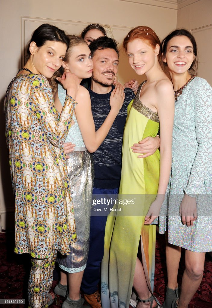 <a gi-track='captionPersonalityLinkClicked' href=/galleries/search?phrase=Cara+Delevingne&family=editorial&specificpeople=5488432 ng-click='$event.stopPropagation()'>Cara Delevingne</a> (2R) and Matthew Williamson (C) pose with models backstage at the Matthew Williamson show during London Fashion Week Fall/Winter 2013/14 at the Royal Opera House on February 17, 2013 in London, England.