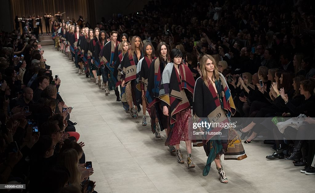 <a gi-track='captionPersonalityLinkClicked' href=/galleries/search?phrase=Cara+Delevingne&family=editorial&specificpeople=5488432 ng-click='$event.stopPropagation()'>Cara Delevingne</a> and models walk the runway with models at the Burberry Prorsum show at Perks Field during London Fashion Week AW14 in at the Kensington Gardens on February 17, 2014 in London, England.