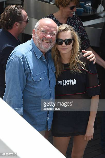 Cara Delevingne and Peter Lindbergh are seen on day 8 of the 67th Annual Cannes Film Festival on May 21 2014 in Cannes France