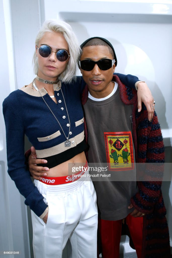 Cara Delevingne and Pharrell Williams attend the Chanel show as part of the Paris Fashion Week Womenswear Fall/Winter 2017/2018 on March 7, 2017 in Paris, France.
