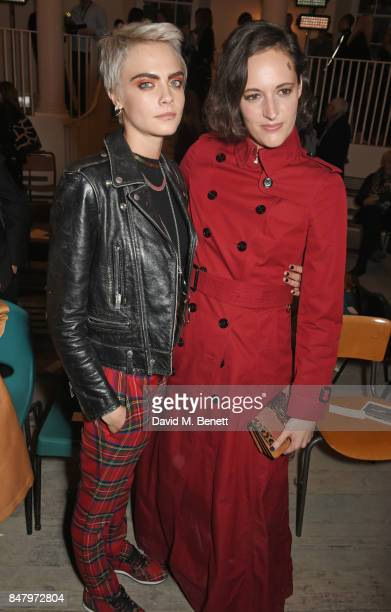 Cara Delevingne and Phoebe WallerBridge wearing Burberry at the Burberry September 2017 at London Fashion Week at The Old Sessions House on September...