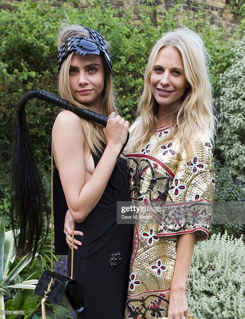 Cara Delevingne and Poppy Delevingne attend The Elephant Family presents 'The Animal Ball' at Lancaster House on July 9 2013 in London England