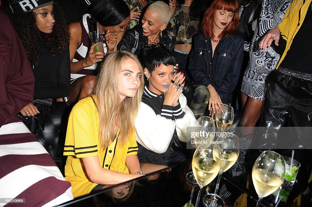 <a gi-track='captionPersonalityLinkClicked' href=/galleries/search?phrase=Cara+Delevingne&family=editorial&specificpeople=5488432 ng-click='$event.stopPropagation()'>Cara Delevingne</a> and <a gi-track='captionPersonalityLinkClicked' href=/galleries/search?phrase=Rihanna&family=editorial&specificpeople=453439 ng-click='$event.stopPropagation()'>Rihanna</a> attends a photocall to launch to <a gi-track='captionPersonalityLinkClicked' href=/galleries/search?phrase=Rihanna&family=editorial&specificpeople=453439 ng-click='$event.stopPropagation()'>Rihanna</a> for River Island SS14 collection on September 10, 2013 in London, England.