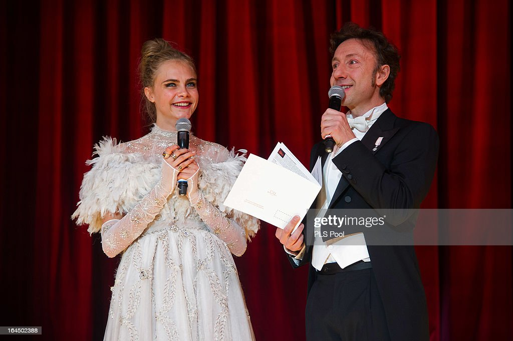 Cara Delevingne and Stephane Bern deliver a speech during the 'Bal De La Rose Du Rocher' in aid of the Fondation Princess Grace on the 150th Anniversary of the SBM at Sporting Monte-Carlo on March 23, 2013 in Monte-Carlo, Monaco.