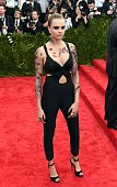 Cara Delevingne arrives at the 2015 Metropolitan Museum of Art's Costume Institute Gala benefit in honor of the museums latest exhibit China Through...