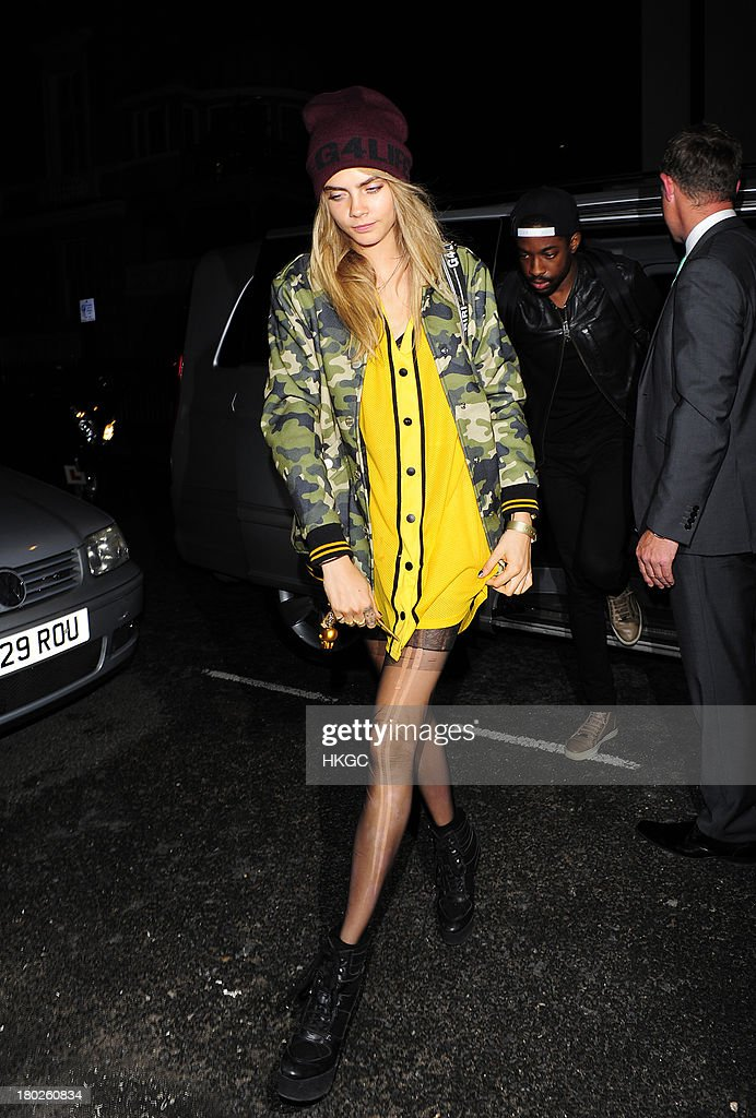 <a gi-track='captionPersonalityLinkClicked' href=/galleries/search?phrase=Cara+Delevingne&family=editorial&specificpeople=5488432 ng-click='$event.stopPropagation()'>Cara Delevingne</a> arrives for dinner with Rihanna at Nozomi restaurant in Knightsbridge. on September 10, 2013 in London, England.