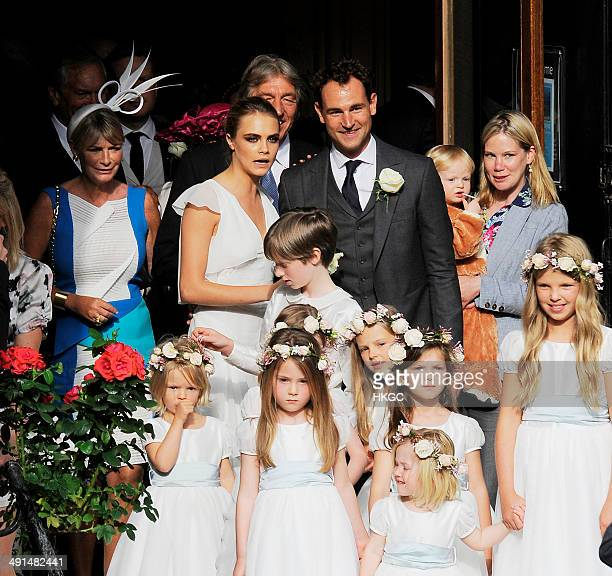 Cara Delevingne at the wedding of Poppy Delevingne and James Cook at St Pauls Church Knightsbridge on May 16 2014 in London England
