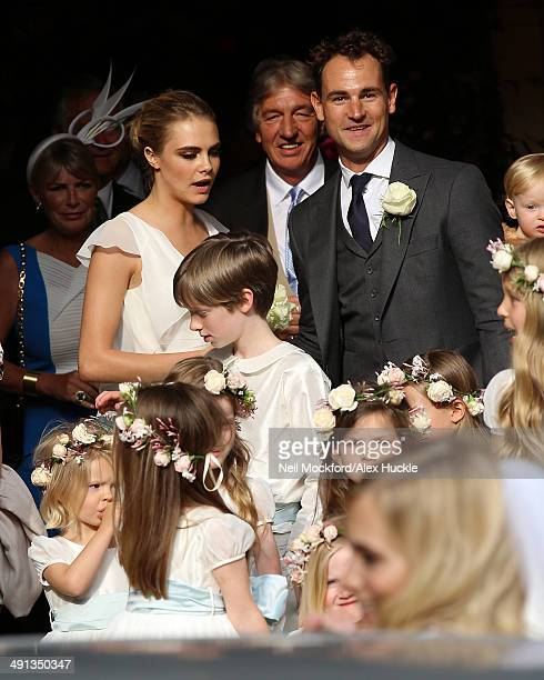 Cara Delevingne at the wedding of Poppy Delevingne and James Cook on May 16 2014 in London England