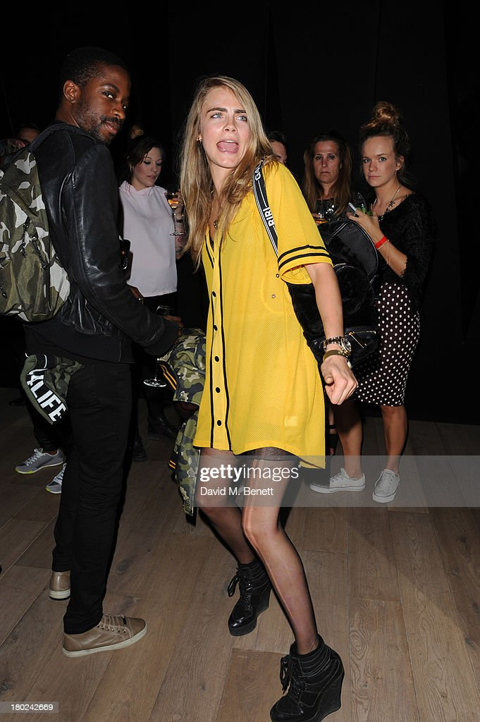 <a gi-track='captionPersonalityLinkClicked' href=/galleries/search?phrase=Cara+Delevingne&family=editorial&specificpeople=5488432 ng-click='$event.stopPropagation()'>Cara Delevingne</a> attends a photocall to launch to <a gi-track='captionPersonalityLinkClicked' href=/galleries/search?phrase=Rihanna&family=editorial&specificpeople=453439 ng-click='$event.stopPropagation()'>Rihanna</a> for River Island SS14 collection on September 10, 2013 in London, England.