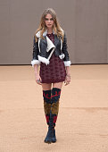Cara Delevingne attends the Burberry Prorsum AW 2015 arrivals during London Fashion Week at Kensington Gardens on February 23 2015 in London England