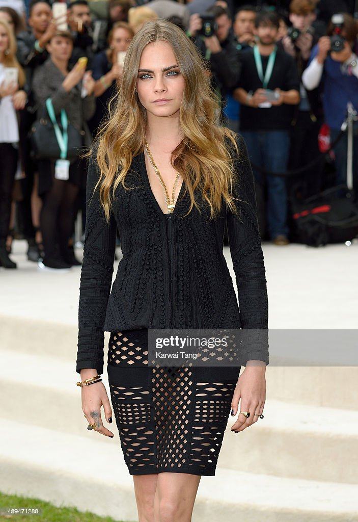 Cara Delevingne attends the Burberry Prorsum show during London Fashion Week Spring/Summer 2016/17 at Kensington Gardens on September 21, 2015 in London, England.