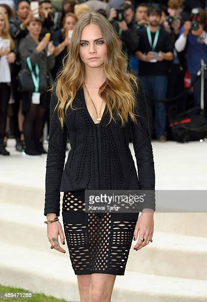 Cara Delevingne attends the Burberry Prorsum show during London Fashion Week Spring/Summer 2016/17 at Kensington Gardens on September 21 2015 in...