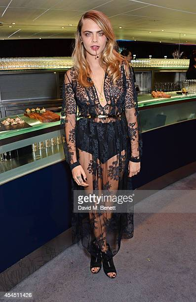 Cara Delevingne attends the GQ Men Of The Year awards in association with Hugo Boss at The Royal Opera House on September 2 2014 in London England