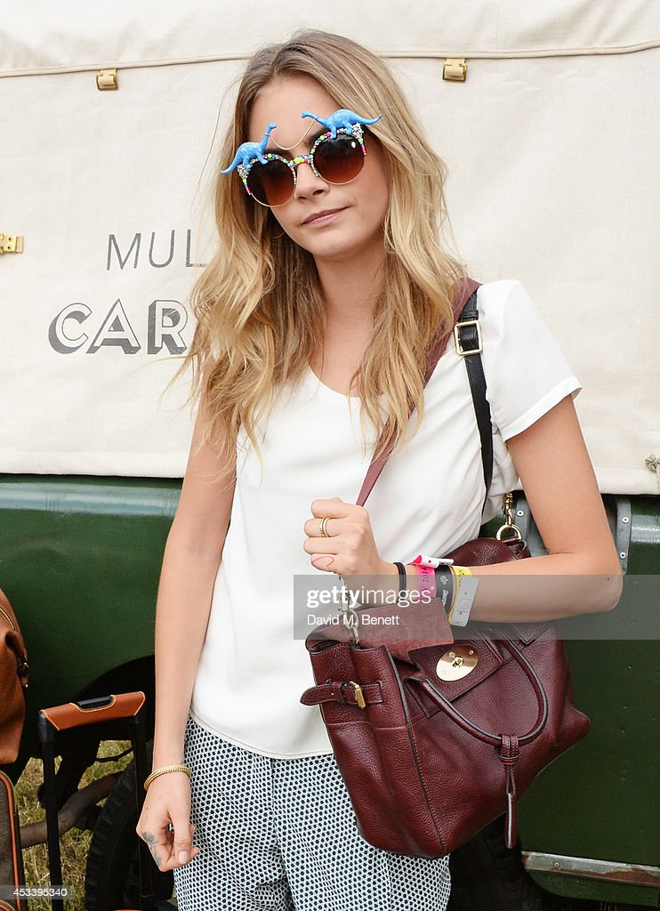 Cara Delevingne attends The Mulberry Wilderness Picnic with Cara Delevingne during Wilderness 2014 at Cornbury Park on August 9 2014 in Oxford England