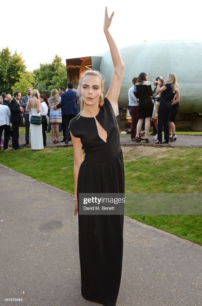 <a gi-track='captionPersonalityLinkClicked' href=/galleries/search?phrase=Cara+Delevingne&family=editorial&specificpeople=5488432 ng-click='$event.stopPropagation()'>Cara Delevingne</a> attends The Serpentine Gallery Summer Party co-hosted by Brioni at The Serpentine Gallery on July 1, 2014 in London, England.