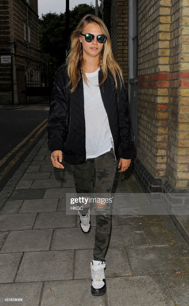 <a gi-track='captionPersonalityLinkClicked' href=/galleries/search?phrase=Cara+Delevingne&family=editorial&specificpeople=5488432 ng-click='$event.stopPropagation()'>Cara Delevingne</a> head to Shoreditch, East London for a night out with her pals on July 2, 2014 in London, England.