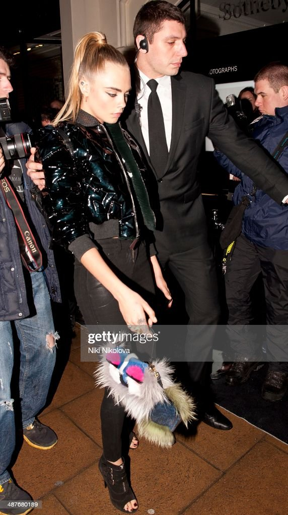 <a gi-track='captionPersonalityLinkClicked' href=/galleries/search?phrase=Cara+Delevingne&family=editorial&specificpeople=5488432 ng-click='$event.stopPropagation()'>Cara Delevingne</a> is seen arriving at Sotheby's, Matfair on April 30, 2014 in London, England.