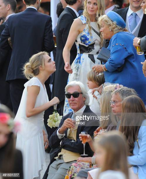 Cara Delevingne is seen at Poppy Delevingne and James Cook's wedding reception held in Kensington Palace Gardens on May 16 2014 in London England