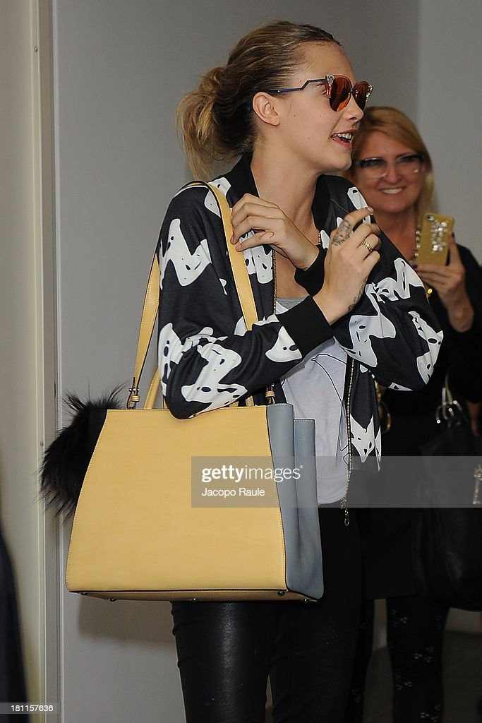 <a gi-track='captionPersonalityLinkClicked' href=/galleries/search?phrase=Cara+Delevingne&family=editorial&specificpeople=5488432 ng-click='$event.stopPropagation()'>Cara Delevingne</a> is seen leaving Fendi during Milan Fashion Week Womenswear Spring/Summer 2014 on September 19, 2013 in Milan, Italy.