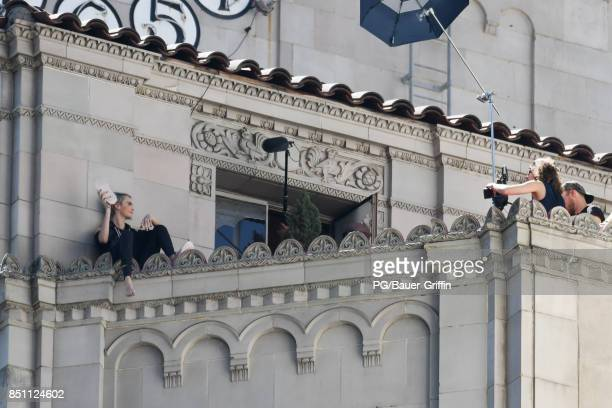 Cara Delevingne is seen on the ledge of a high rise during a photoshoot for Puma and Milk Studios with photographer Cass Bird on September 21 2017 in...