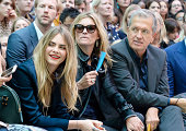 Cara Delevingne Kate Moss and Mario Testino attend the front row at the Burberry Womenswear SS15 show during London Fashion week at Kensington...