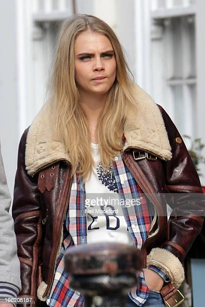 Cara Delevingne on a photoshoot on Portobello Road in Notting Hill on April 10 2013 in London England