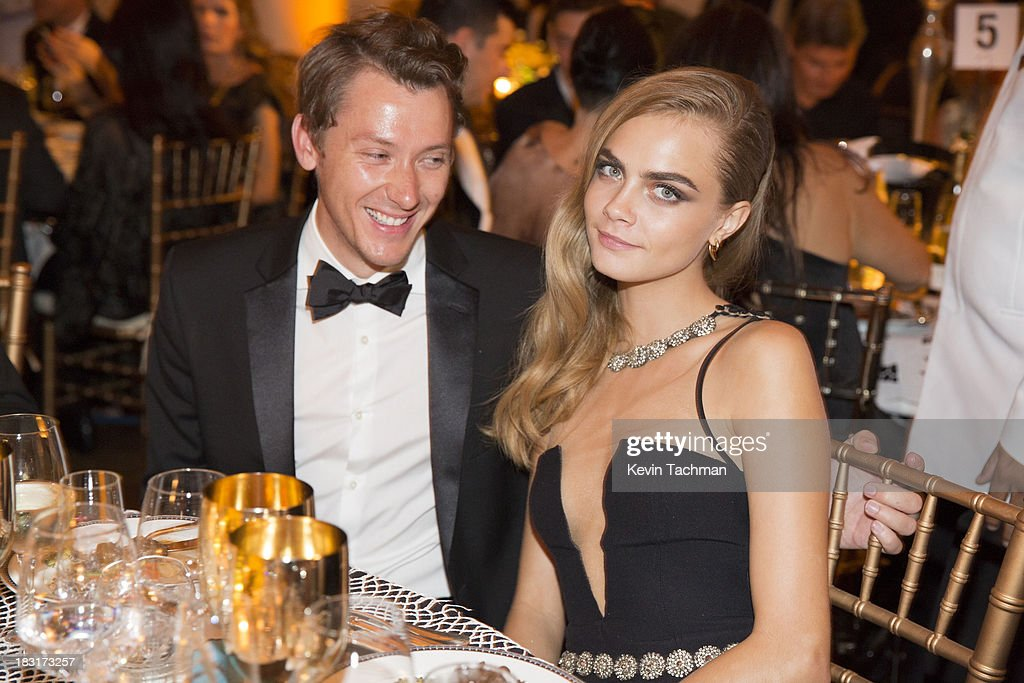 <a gi-track='captionPersonalityLinkClicked' href=/galleries/search?phrase=Cara+Delevingne&family=editorial&specificpeople=5488432 ng-click='$event.stopPropagation()'>Cara Delevingne</a>, right, attends the amfAR Inspiration Gala Rio on October 4, 2013 in Rio de Janeiro, Brazil.