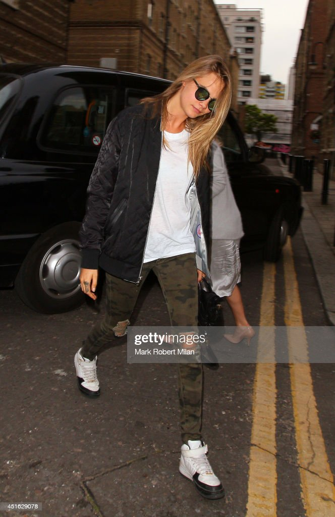 <a gi-track='captionPersonalityLinkClicked' href=/galleries/search?phrase=Cara+Delevingne&family=editorial&specificpeople=5488432 ng-click='$event.stopPropagation()'>Cara Delevingne</a> sighting on July 2, 2014 in London, England.