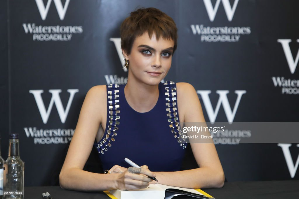 """Cara Delevingne Signs Copies Of Her New Book """"Mirror, Mirror"""" At Waterstones Piccadilly"""