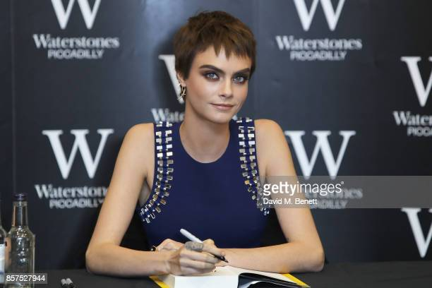 Cara Delevingne signs copies of her new book 'Mirror Mirror' at Waterstones Piccadilly on October 4 2017 in London England