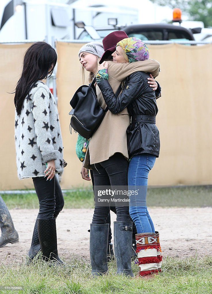 Cara Delevingne, sister Poppy Delevingne and Alexa Chung during/performs at day 2 of the 2013 Glastonbury Festival at Worthy Farm on June 28, 2013 in Glastonbury, England.