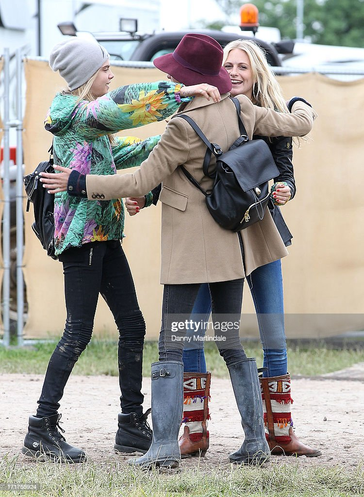 Cara Delevingne, sister Poppy Delevingne and Alexa Chung join at day 2 of the 2013 Glastonbury Festival at Worthy Farm on June 28, 2013 in Glastonbury, England.