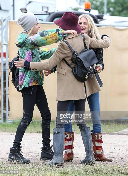 Cara Delevingne sister Poppy Delevingne and Alexa Chung join at day 2 of the 2013 Glastonbury Festival at Worthy Farm on June 28 2013 in Glastonbury...